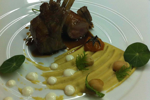 Milk fed lamb with chickpeas puree and goat cheese cream.