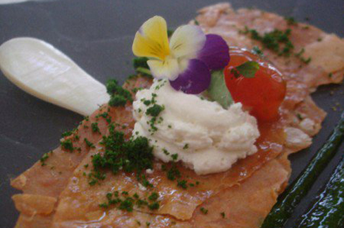 Ntakos on crispy chicken skin, espuma cretan cheese. Tomatoes hearts, oregano snow.
